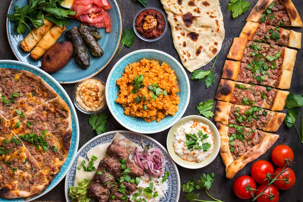 Traditional assorted turkish dishes. Turkish pizza meat kebab pita bulgur fried meatballs hummus and turkish meze set. Middle eastern dinner. Food party. Turkish cuisine. Top view. Eastern food