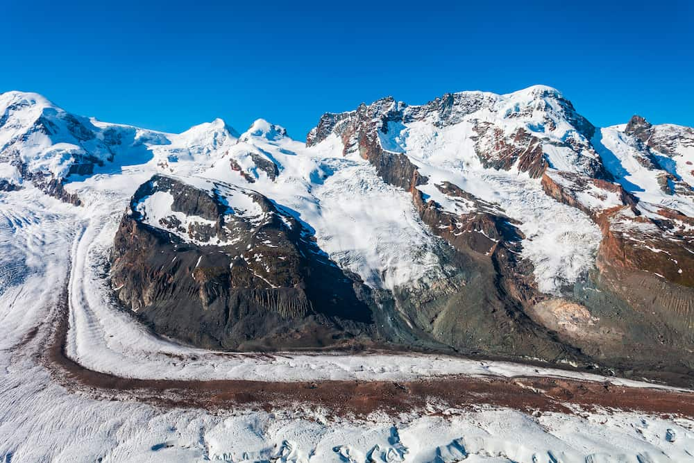 Monte Rosa mountain massif and Gorner Glacier panoramic view from the Gornergrat viewpoint near Zermatt town, Switzerland