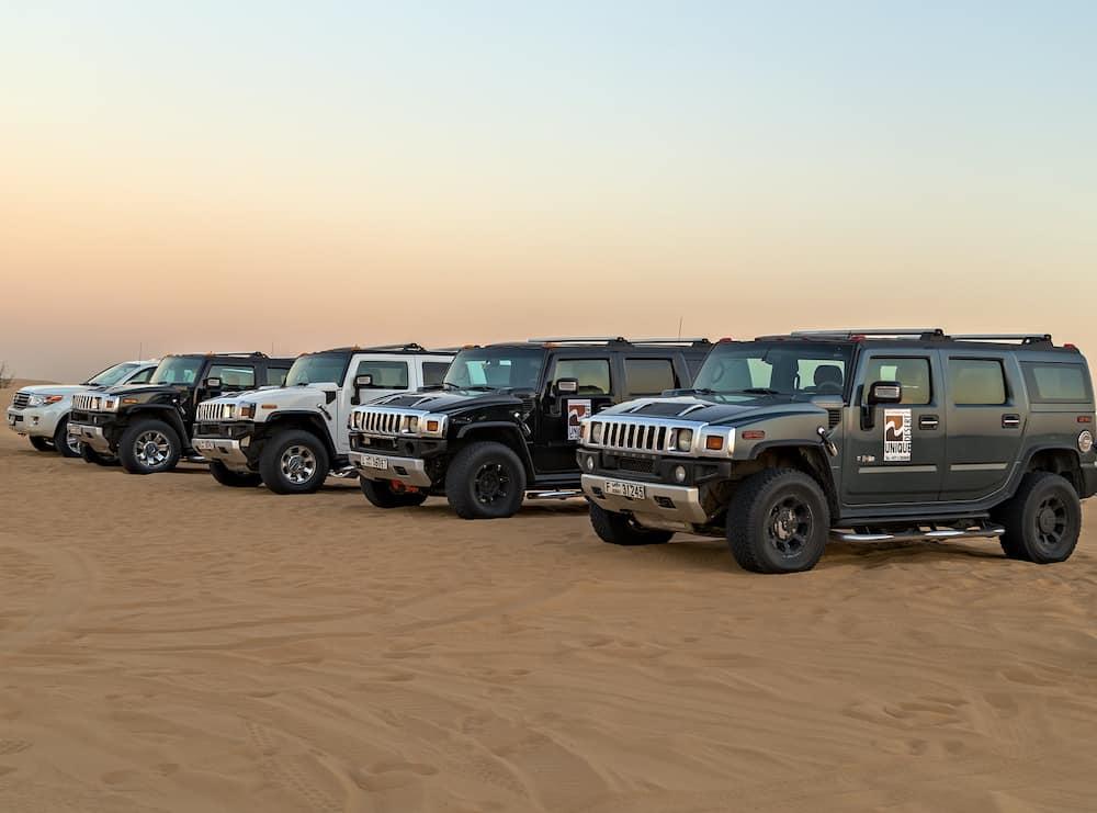DUBAI, UNITED ARAB EMIRATES - Safari Hummer H2 rally off road parking in desert safari, Dubai, UAE