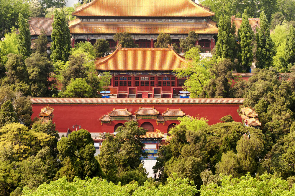Chinese buildings within Jingshan park located within the city of Beijing China.