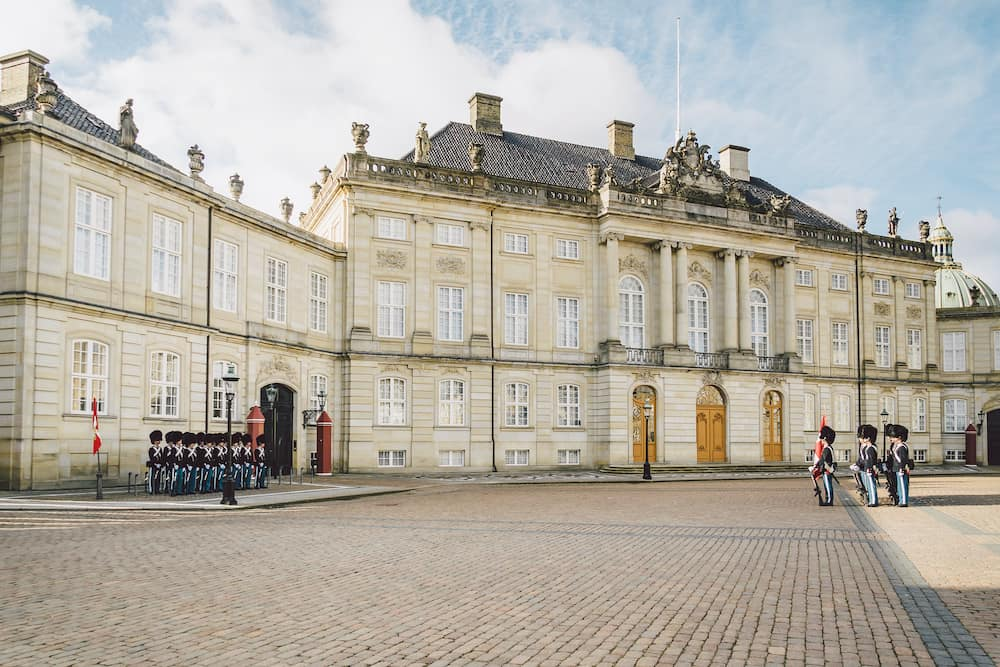 Denmark. Copenhagen. Amalienborg Square. Changing the royal guard. Army ranks uniform people defense castle king