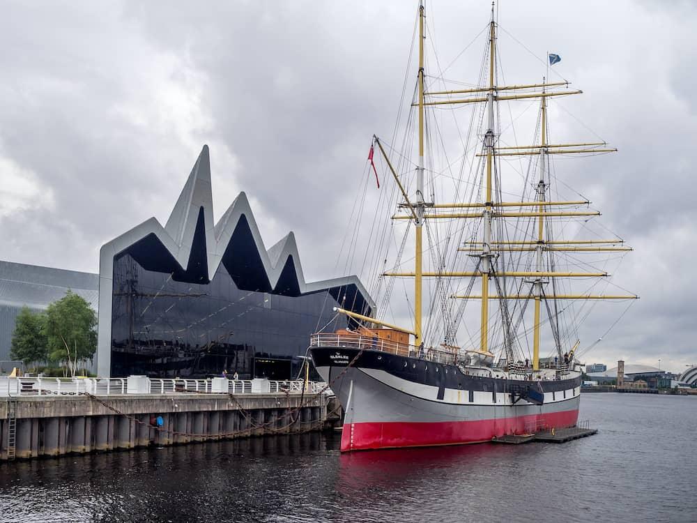GLASGOW, SCOTLAND - The Glenlee sailing ship along the Riverside Museum July 22, 2017 in Glasgow, Scotland. The Riverside Museum is the Museum of Transport in Scotland.