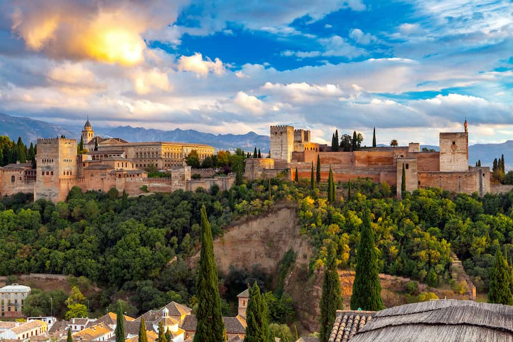 Walls and towers of the fortress of the Alhambra at sunset in Granada. Andalusia. Spain.