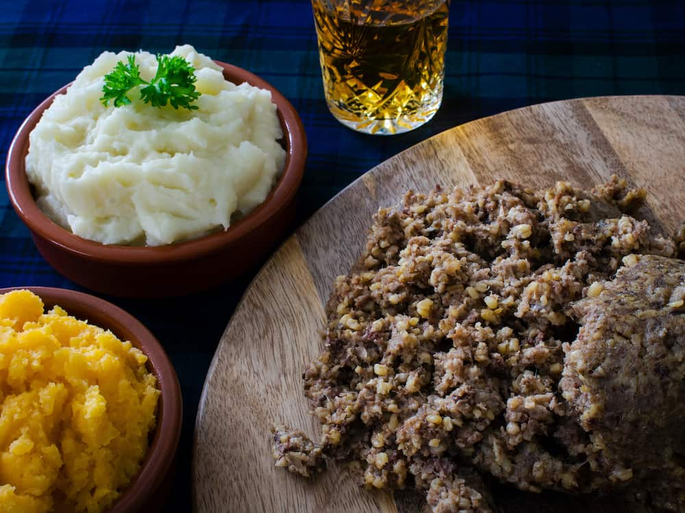 Haggis, with mashed potatoes, mashed swede and a wee dram of Scotch whisky. Burns Night, Scotland