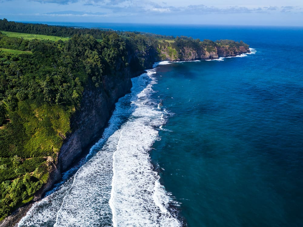 Aerial view of the northern coast of the Big Island with steep green cliffs, Hawaii