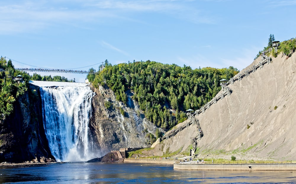 QUEBEC, CANADA - : The Montmorency Falls is a waterfall on the Montmorency River in Quebec, Canada. The many tourists that visit there are treated to many ways to see the falls