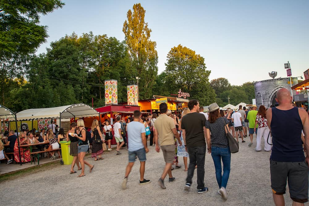 Munich,Germany- People walk on the grounds of the Tollwood Festival