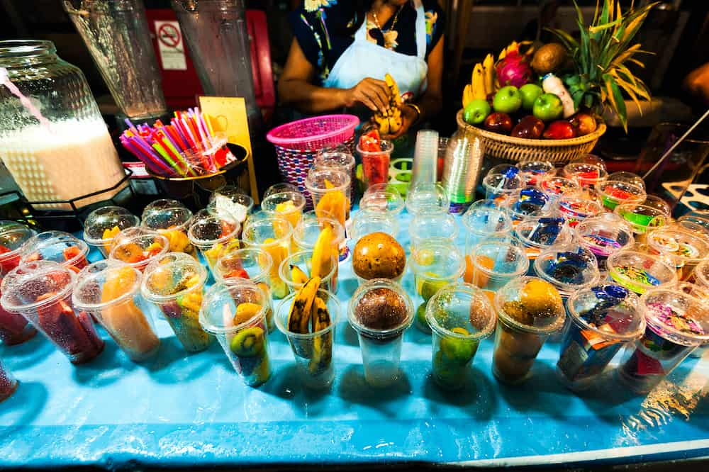 Thailand, Phuket - Street food seller at the night market in Thailand. Street kitchen. Street food. Night market. Asian cuisine. Fresh juice