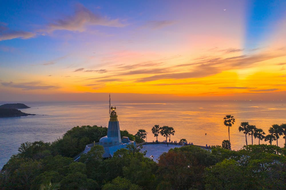 aerial photography sunset above the great lighthouse at Promthep cape Phuket Thailand
