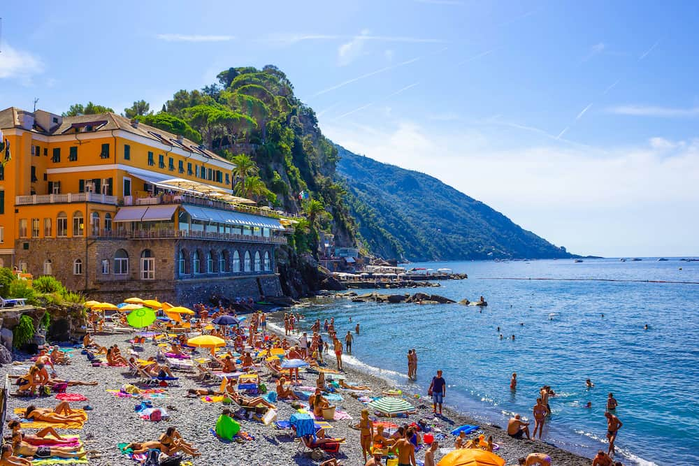 Camogli, Italy - People resting at beach at Camogli on sunny summer day, Liguria, Italy