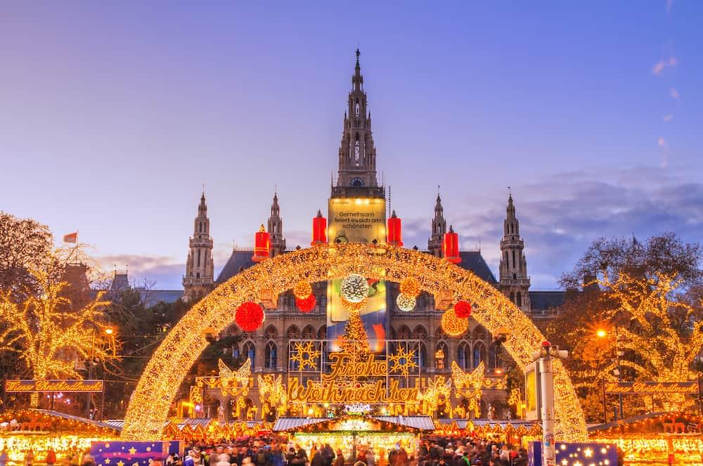 Festive cityscape - view of the Vienna Christmas World and Vienna City Hall (Wiener Rathaus) on Rathausplatz, Austria