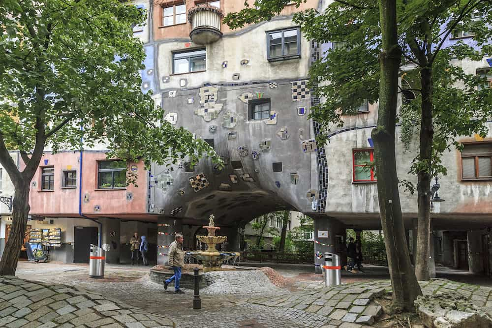 VIENNA, AUSTRIA - This is a street and a fountain at the arched passage into the courtyard of the Hundertwasser House.