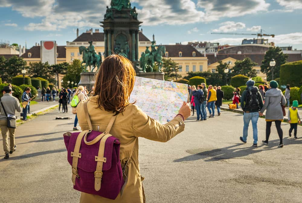 Traveler girl with map in vacation.