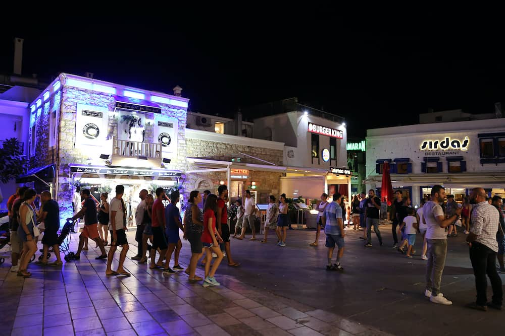 MUGLA TURKEY - People in Bodrum bar street at night. Bodrum bar street is one of the most famous nightlife district in Turkey.