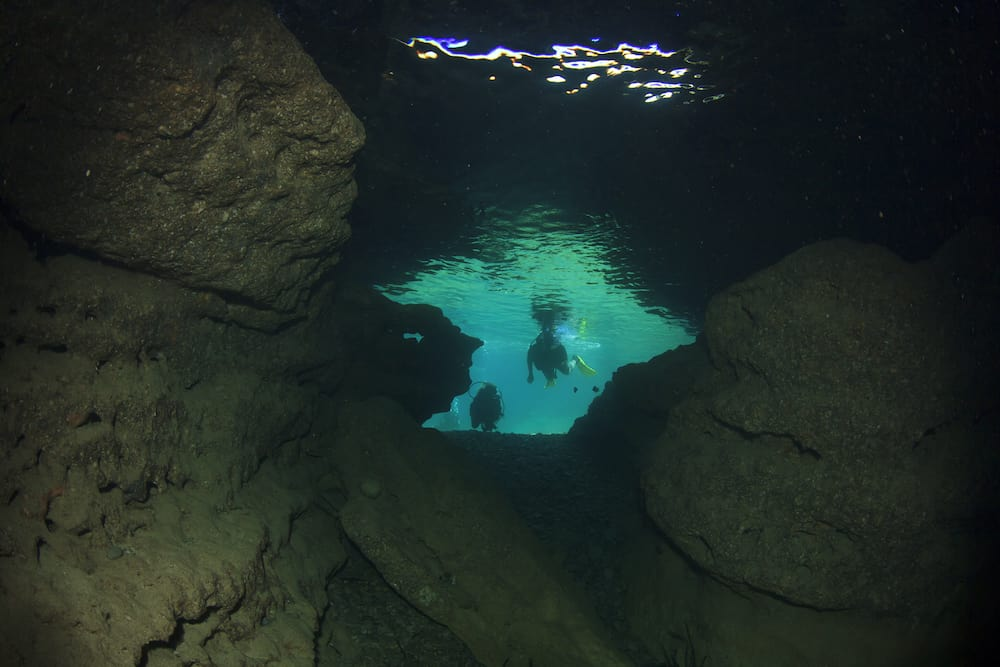 Underwater cave and scuba divers