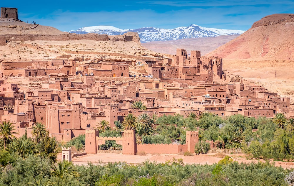 Fortified village and clay houses of an ancient settlement, Ait Benhaddou, Morocco with the atlas mountains in the background