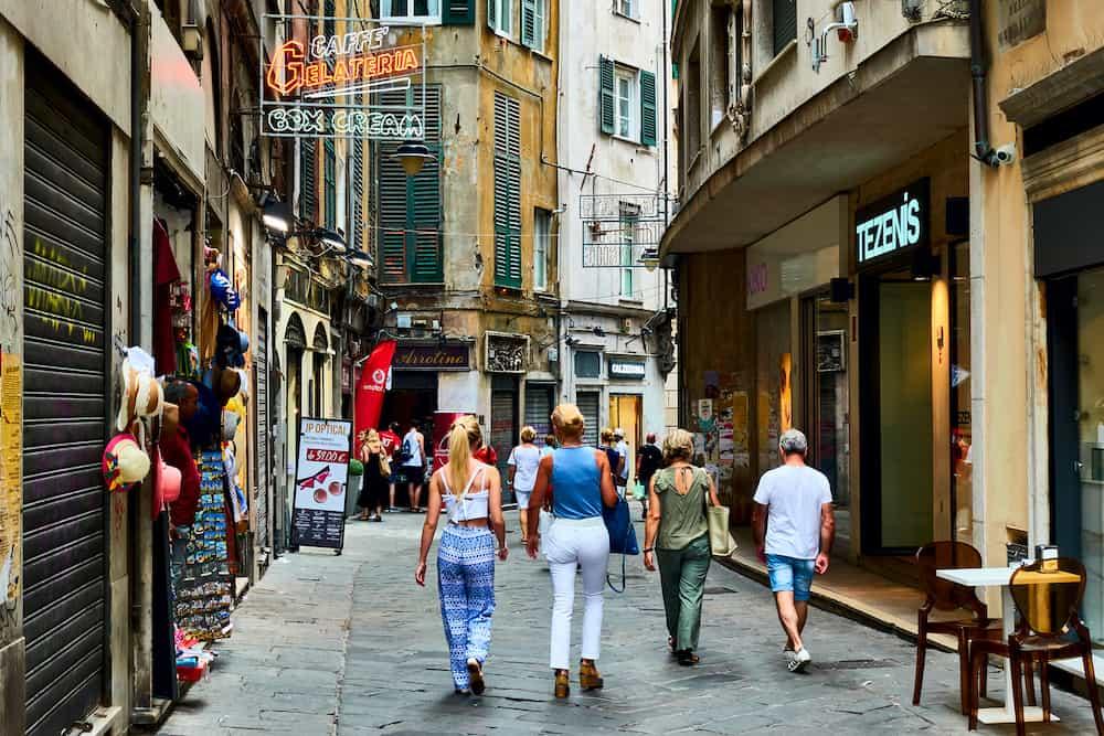 Genoa (Genova), Italy - Old street in Genoa with walking people