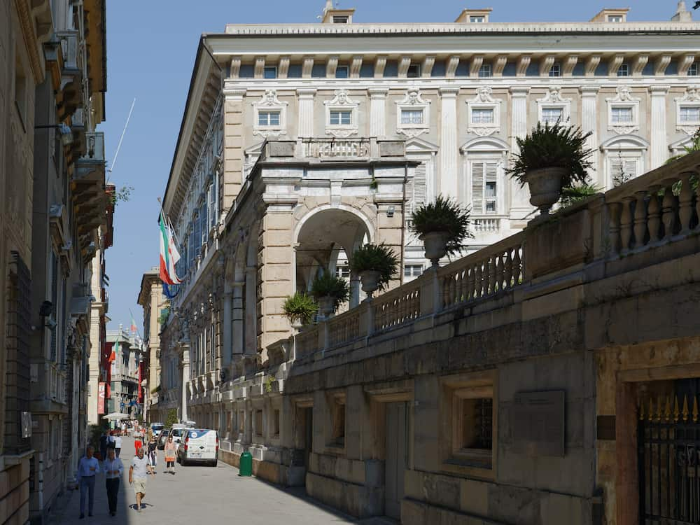 GENOA, ITALY - People at the Palazzo Doria Tursi on via Garibaldi, former Le Strade Nuove. The street with Palazzi dei Rolli is listed as UNESCO World Heritage site