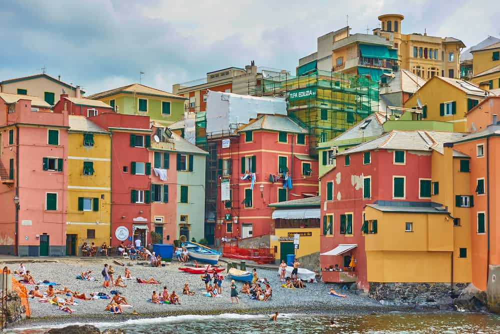 Genoa, Italy - People by the sea on Boccadasse beach in Genoa, Liguria