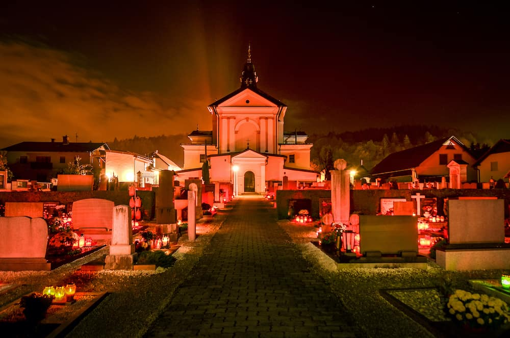 Ljubljana Slovenia - candles and lantern burning on graves at Cemetery at night for a catholic - christian holiday All Saints' Day. Solemnity of All Saints. All Hallows eve. November 1st. Feast of All Saints. Hallowmas. All Souls' Day.