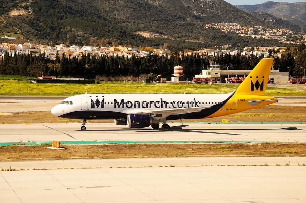 MALAGA, SPAIN - Monarch Airlines Airbus A320 taxiing at the airport, Malaga, Spain,