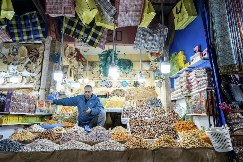 Marrakech, Morocco - Man presenting his shop with delicious baklavas located in old town of Marrakech