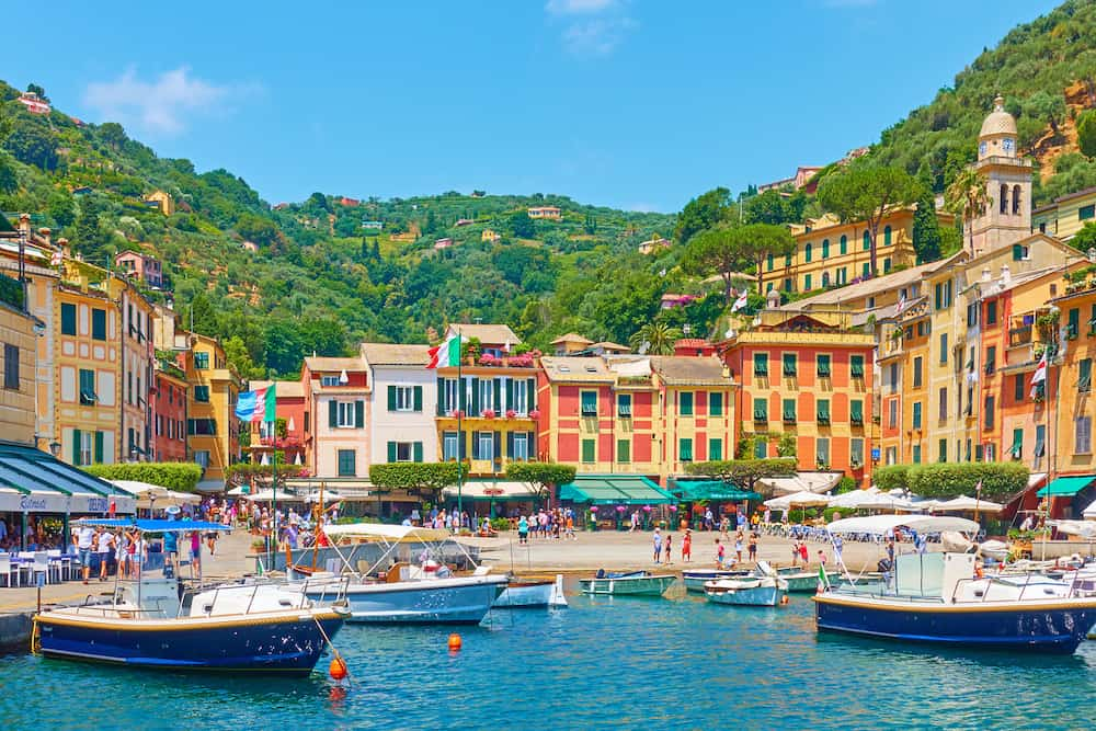 Portofino, Italy - Small port with yachts and boats in Portofino town on summer sunny day