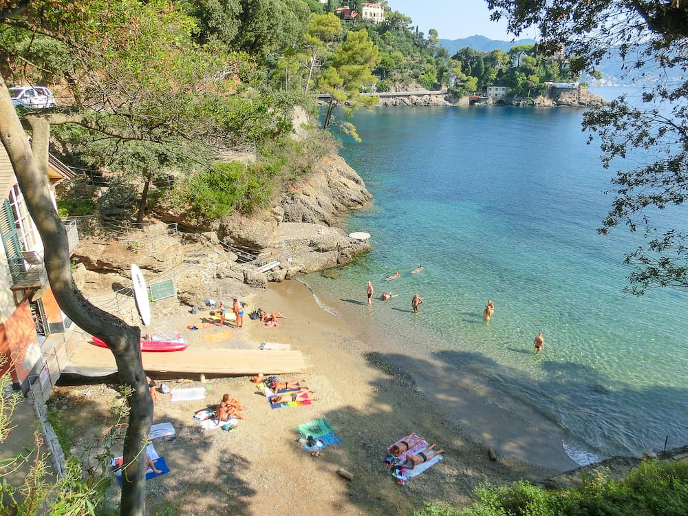 Portofino, Italy - The sand beach known as paraggi near portofino in genoa on a blue sea background