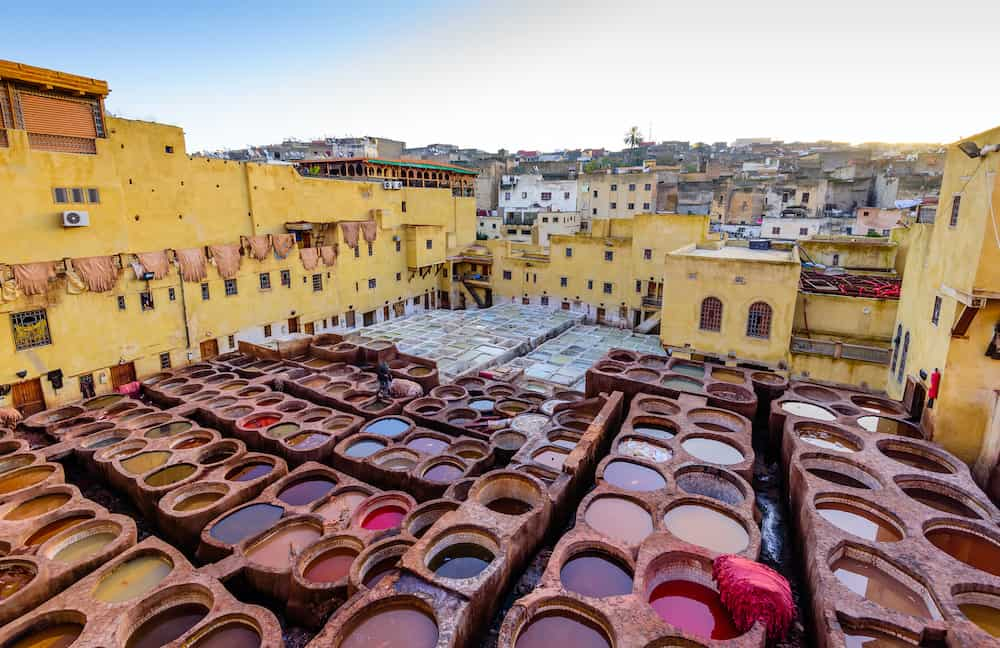 Fez, Morocco - Sightseeing of Morocco. Tanneries of Fez. Dye reservoirs and vats in traditional tannery of city of Fez
