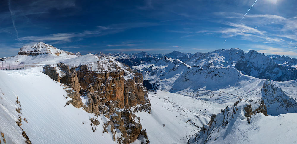 Panorama of a ski resort piste and Dolomites mountains in Italy from Passo Pordoi pass. Arabba, Italy