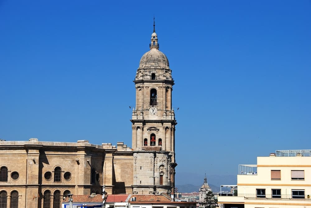 MALAGA, SPAIN - Elevated view of the Cathedral bell tower, Malaga, Malaga Province, Andalucia, Spain, Western Europe