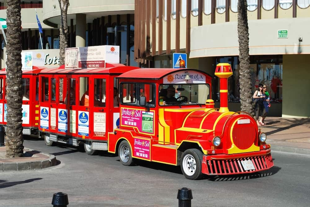 FUENGIROLA, SPAIN - Tourist train shaped bus travelling around the town Fuengirola Malaga Province Andalusia Spain Western Europe