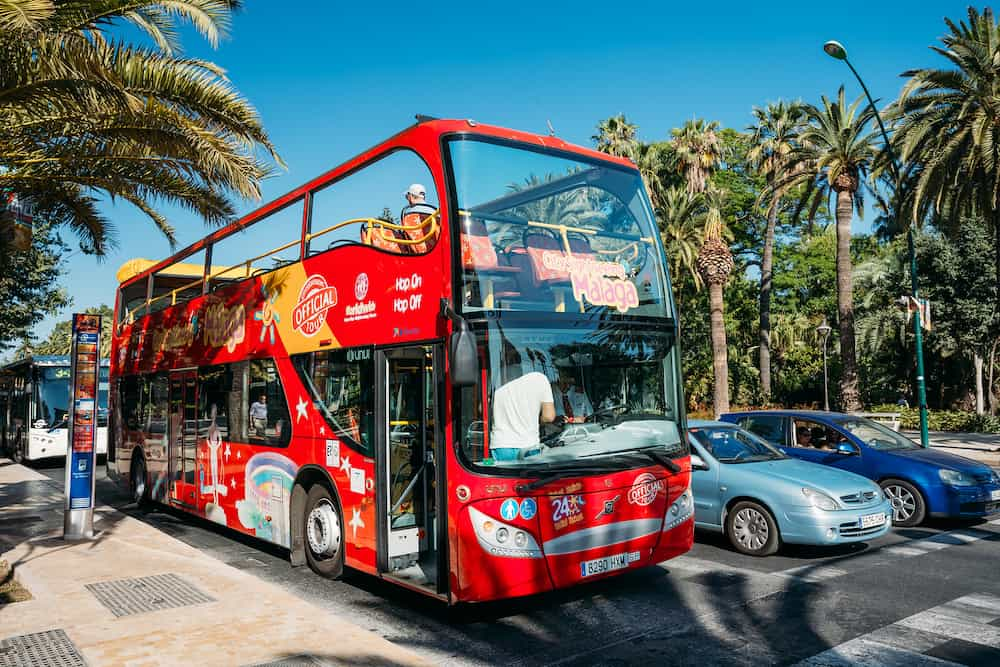 Malaga, Spain - Touristic bus on street. City sightseeing Malaga is a new official touristic bus service that shows the city.