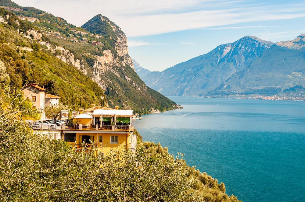 Garda lake, Lombardy, Italy - Scenic view from the edge of western coast of Garda lake on beautiful northern Italian nature surrounding this amazing lake. Rocky mountains landscape