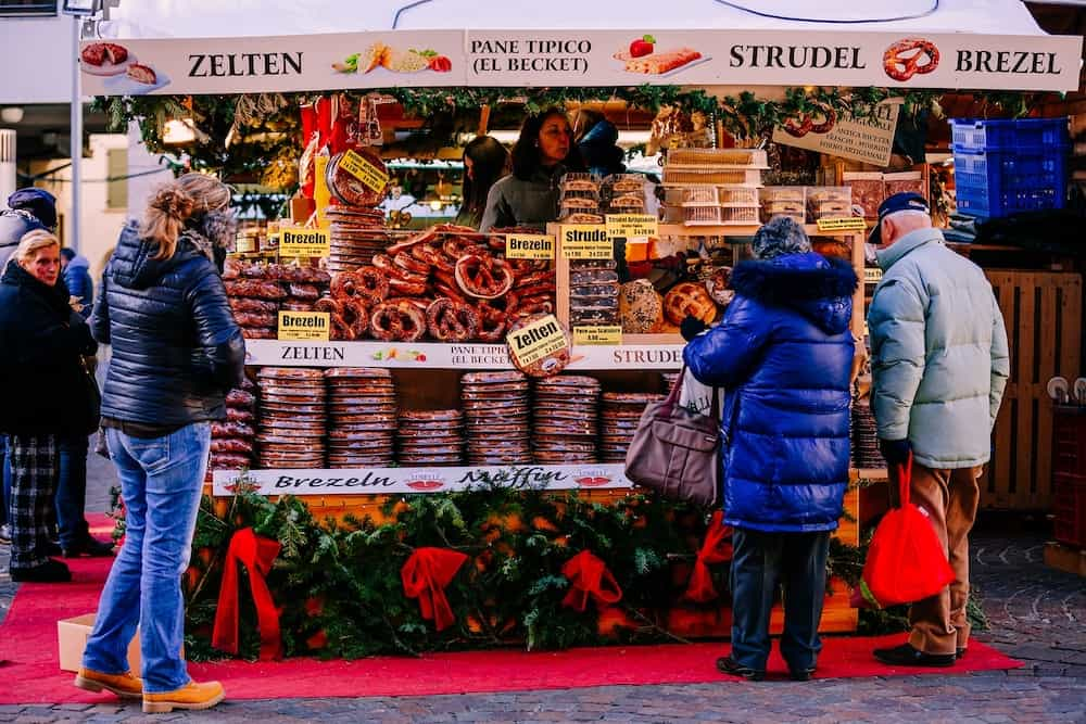 TRENTO ALTO ADIGE ITALY - pretzels strudel and others typical products at the traditional Christmas market. Alto Adige Italy