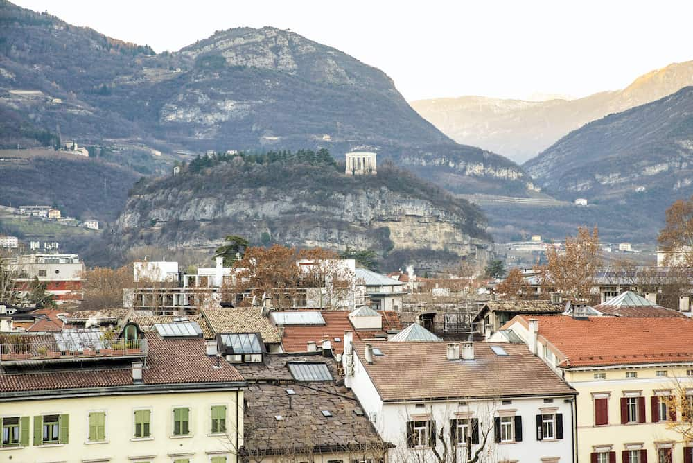 top view of the city of Trento, Italy. on the hill a small temple