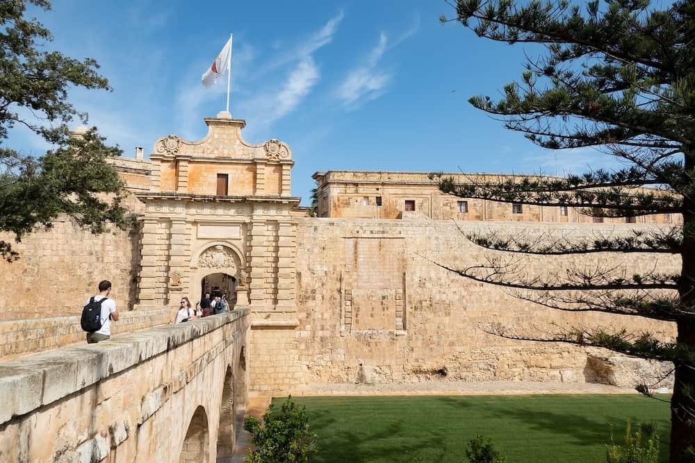 MDINA, MALTA - Bridge and Mdina Gate to the historical complex of buildings ner Il-Rabat